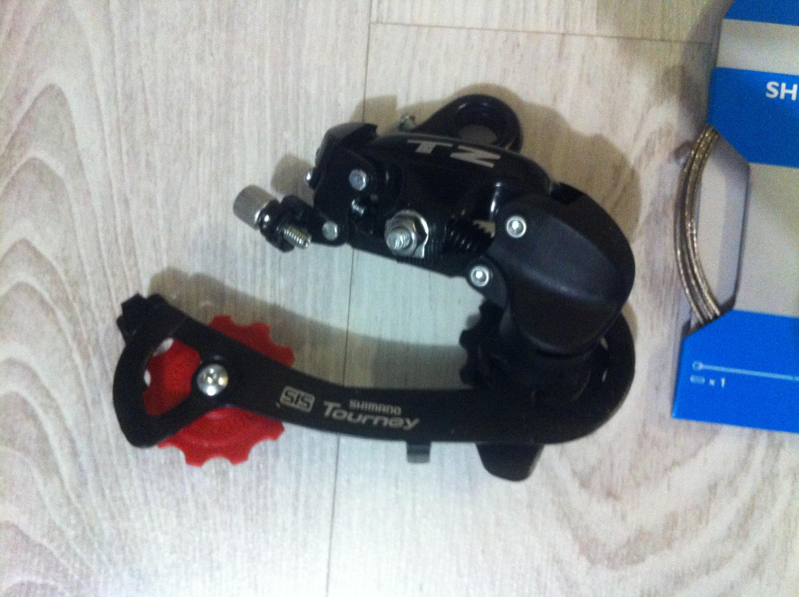 Переключатель задний Shimano Tourney RD-TZ50 с креплением на петух на 6 скоростей